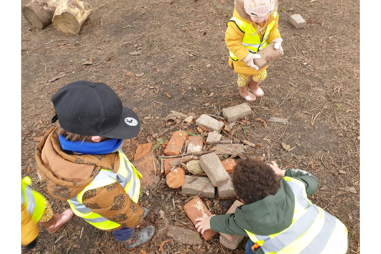 Nursery children playing with bricks